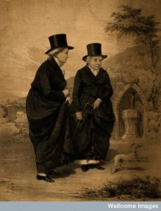V0007359 Sarah Ponsonby (left) and Lady Eleanor Butler, known as the Ladies of Llangollen, outside with a dog. Lithograph by J.H. Lynch, 183-, after Mary Parker (later Lady Leighton), 1828. By: Mary Leighton after: James Henry Lynch, Quelle: wellcomeimages.org, @ CC BY 4.0